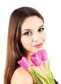 Chica joven y bella con los tulipanes en la mano, aislado en blanco — Foto de Stock