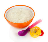 Powdered milk in bowl with spoon and nipple for baby isolated on white — Stock Photo