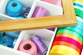 Material for sewing in white wooden box closeup — Stock Photo