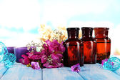 Spa oil and freesia on light background — Stock Photo