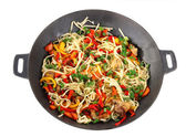 Noodles with vegetables on wok isolated on white — Stock Photo