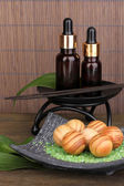 Aromatherapy setting on brown bamboo background — 图库照片