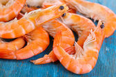 Shrimps on blue wooden table — Stockfoto