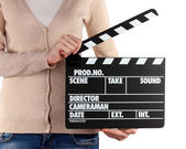 Movie production clapper board in hands isolated on white — Stock Photo
