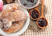 Taste croissants on plate and jam on tableclot — Foto de Stock