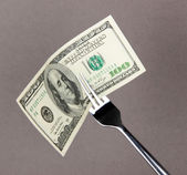 Banknotes on fork on grey background — Stockfoto