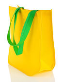 Yellow bag with green handles isolated on whit — Stock Photo