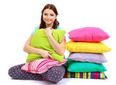 Beautiful young girl with pillows isolated on whit — Stock Photo
