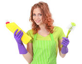 Young woman wearing rubber gloves with cleaning supplies, isolated on white — Stock Photo