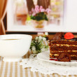 Cup of tea and delicious cake on window background — Stock Photo #24085171