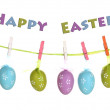 Colorful easter eggs hanging on ribbon isolated on white — Stock Photo