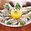 Oysters on table in cafe - Stock Photo