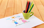 Colorful pencils in cup on table — Стоковое фото