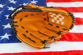 Baseball glove on American flag background — Stock Photo