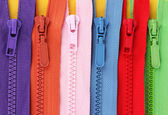 Multicolored zippers closeup — Stock Photo
