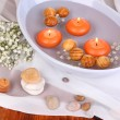 Stock Photo: Beautiful candles swim in beautiful plate on wooden table close-up