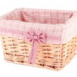 Stock Photo: Wicket basket with pink fabric and bow, isolated on white