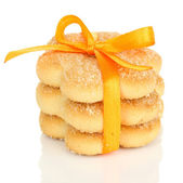 Sweet cookies tied with orange ribbon isolated on white — Stock Photo