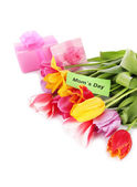 Beautiful tulips in bouquet with gifts and note isolated on white — Stock Photo