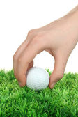 Golf ball in hand isolated on white — Stock Photo