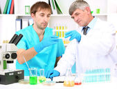 Physician and assayer during research on room background — Stockfoto