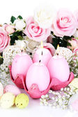 Easter candles with flowers close up — Stock Photo