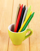 Colorful pencils in cup on table — Stok fotoğraf