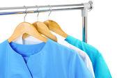 Medical clothing on hunger isolated on white — Stock Photo