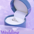 Beautiful box with wedding ring on purple background — ストック写真