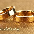 Wedding rings on bright background - Zdjcie stockowe