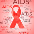 Aids awareness red ribbon on pink background - Photo