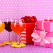 Colorful cocktails with bright decor for glasses on purple background with polka dots - Stock Photo