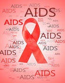 Aids awareness red ribbon on pink background — Stock Photo