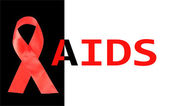 Aids awareness red ribbon isolated on black with aids word — Stock Photo