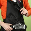 Stock Photo: Hairdresser in uniform with working tools, on color background
