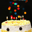 Happy birthday cake, on black background — Stock Photo
