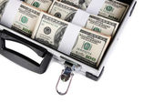 Suitcase with 100 dollar bills isolated on white — Stock Photo