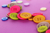 Bright color buttons on a purple background — Stock Photo