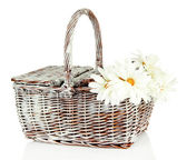 Picnic basket with flowers, isolated on white — Stock Photo