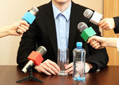 Conference meeting microphone with businessman or politician — Stock Photo