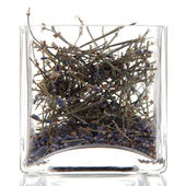 Dried herb in glass container isolated on white — Stock Photo