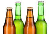 Coloured glass beer bottles isolated on white — Stock Photo