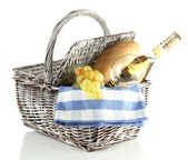 Picnic basket with grape and bottle of wine, isolated on white — Stock Photo