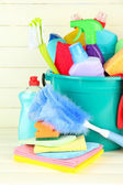 Cleaning items in bucket on white wooden background — Foto Stock