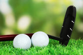 Golf balls and driver on green grass outdoor close up — Stok fotoğraf