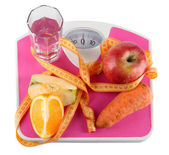 Fruit on scales isolated on white — Stock Photo