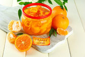 Orange jam with zest and tangerines, on white wooden table — Stok fotoğraf