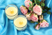 Candles on blue fabric close-up — Stock Photo