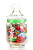 Glass jar containing various colored buttons isolated on white — Stock Photo