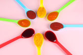 Baby puree in spoons on pink background — Stock Photo